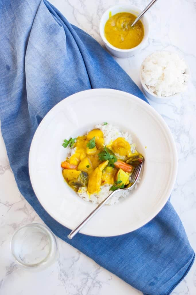 Thai Yellow Coconut Curry in bowl over jasmine rice