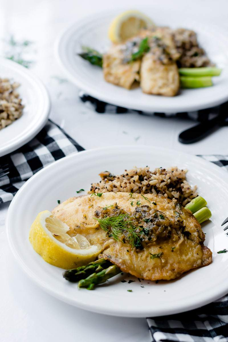 lemon herb tilapia served with brown rice and asparagus