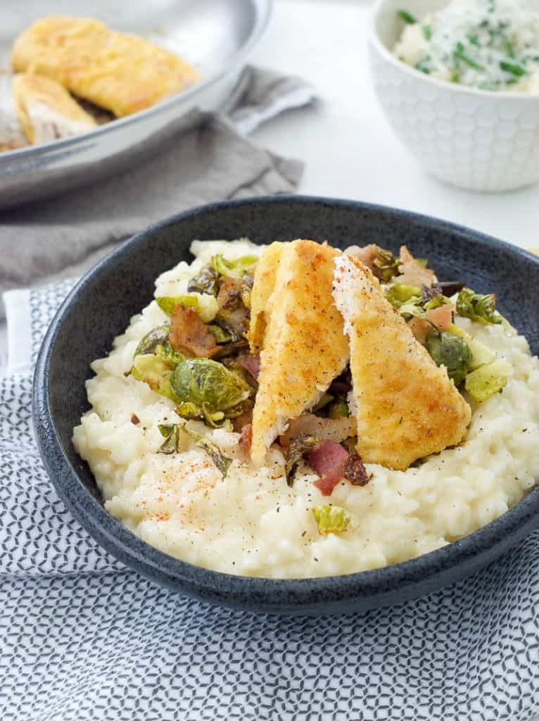 close up shot of Crisp Mahi-Mahi with Bacon Brussels and Risotto