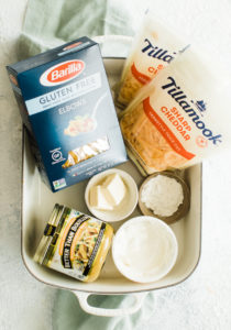 pasta, cheese and broth plus other ingredients for creamy mac and cheese recipe
