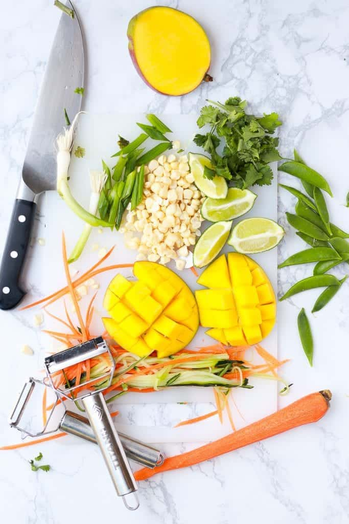 thai buddha bowl ingredients on a cutting board