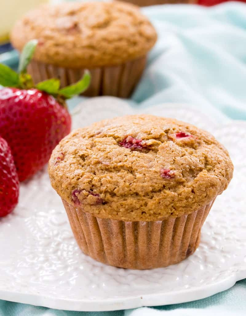 A close up of Strawberry Bran Muffins on a white plate