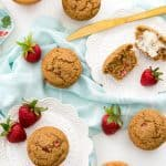 An overhead shot of strawberry bran muffins on white plates