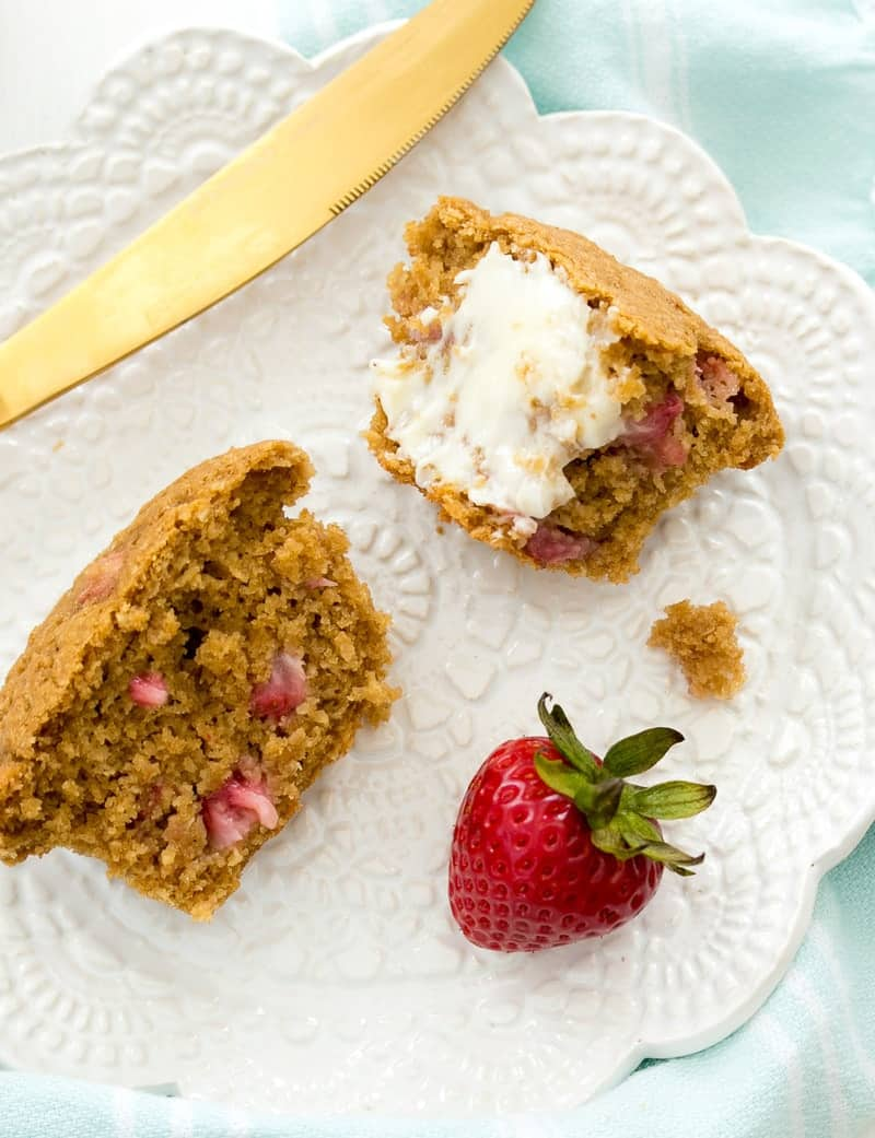 Strawberry Bran Muffins cut in half on a white plate