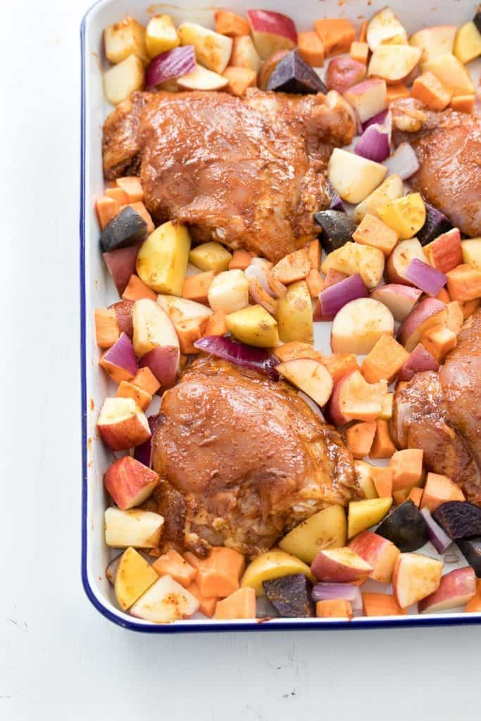 Spicy, Sticky Chicken with Roasted Apple and Potatoes | homemade chicken recipes | one pan meals | easy dinner recipes | one sheet pan meals | sheet pan dinners | easy clean up meals | dinner recipes using chicken | family friendly dinners | homemade dinner recipes || Oh So Delicioso