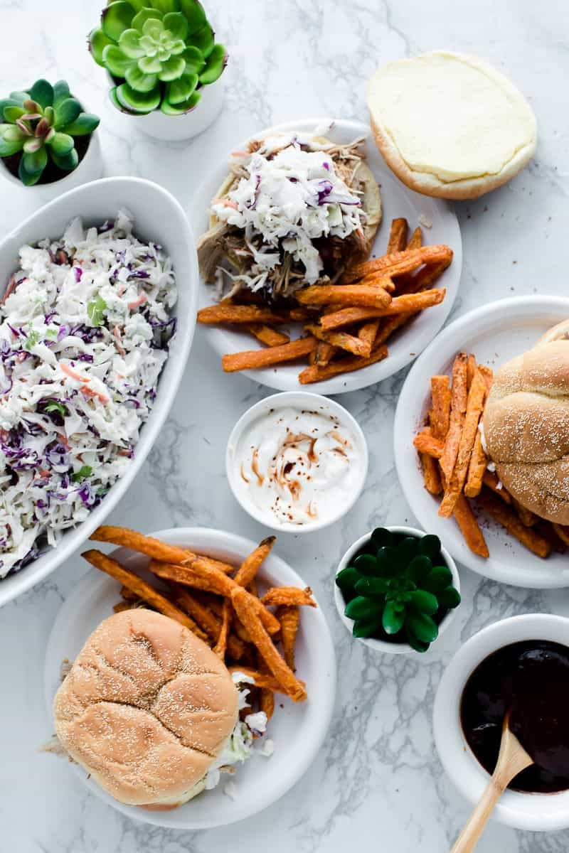 Blue Slaw on BBQ sandwich served with sweet potato fries, succulents to the side