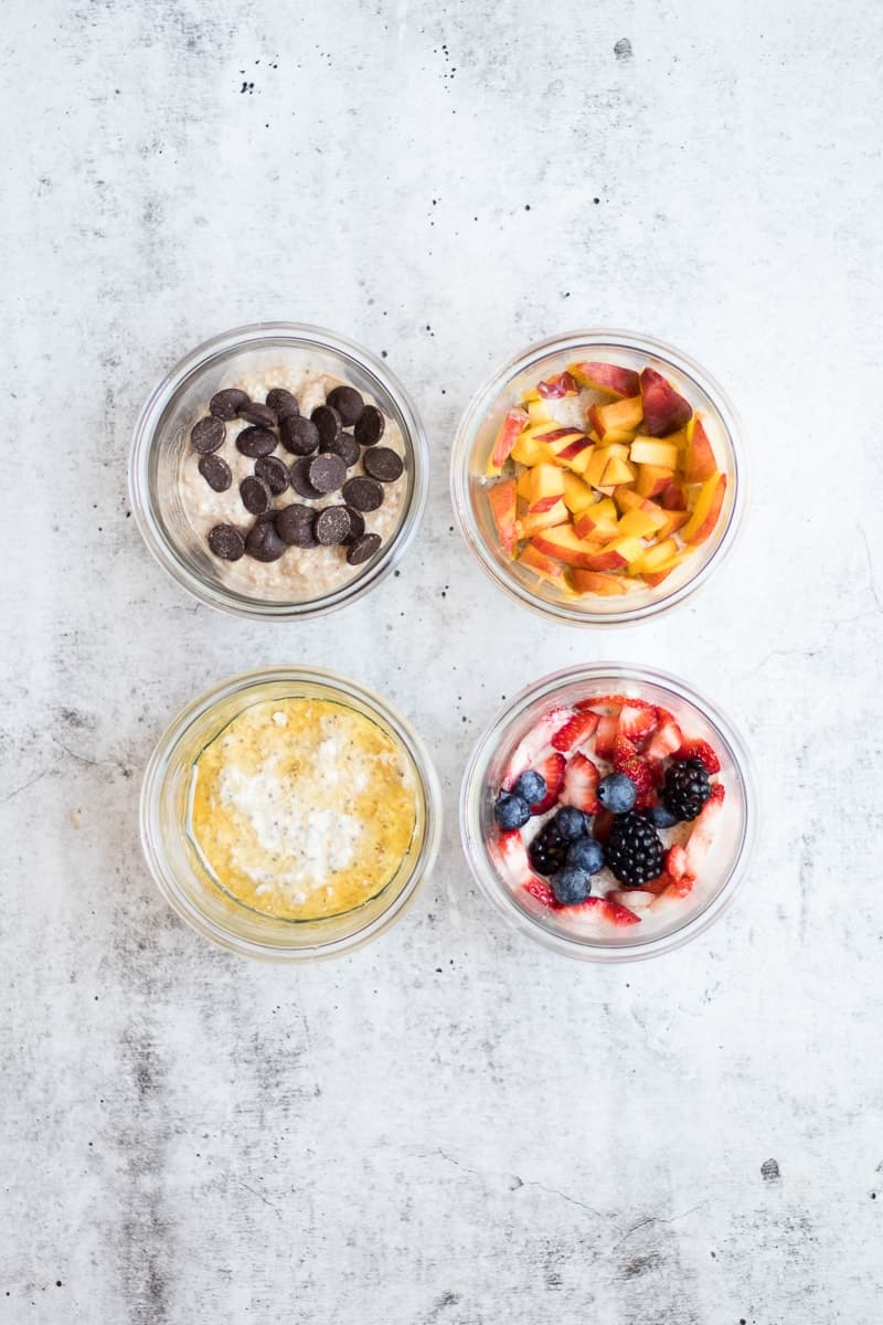 Four jars of Overnight Oats topped with fruit and chocolate chips