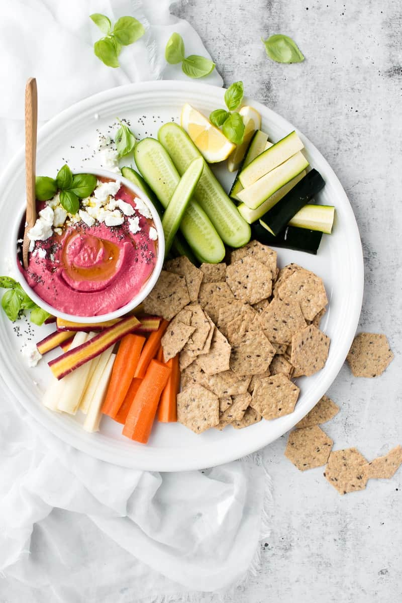 An overhead shot of Pickled Beet Hummus with Goat Cheese and crackers
