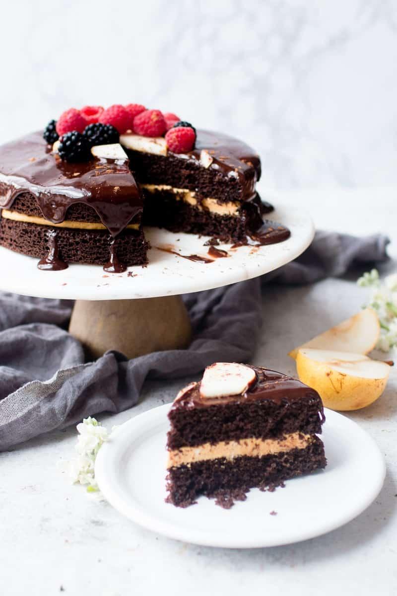 Chocolate Harvest Cake slice with cake on a cake stand