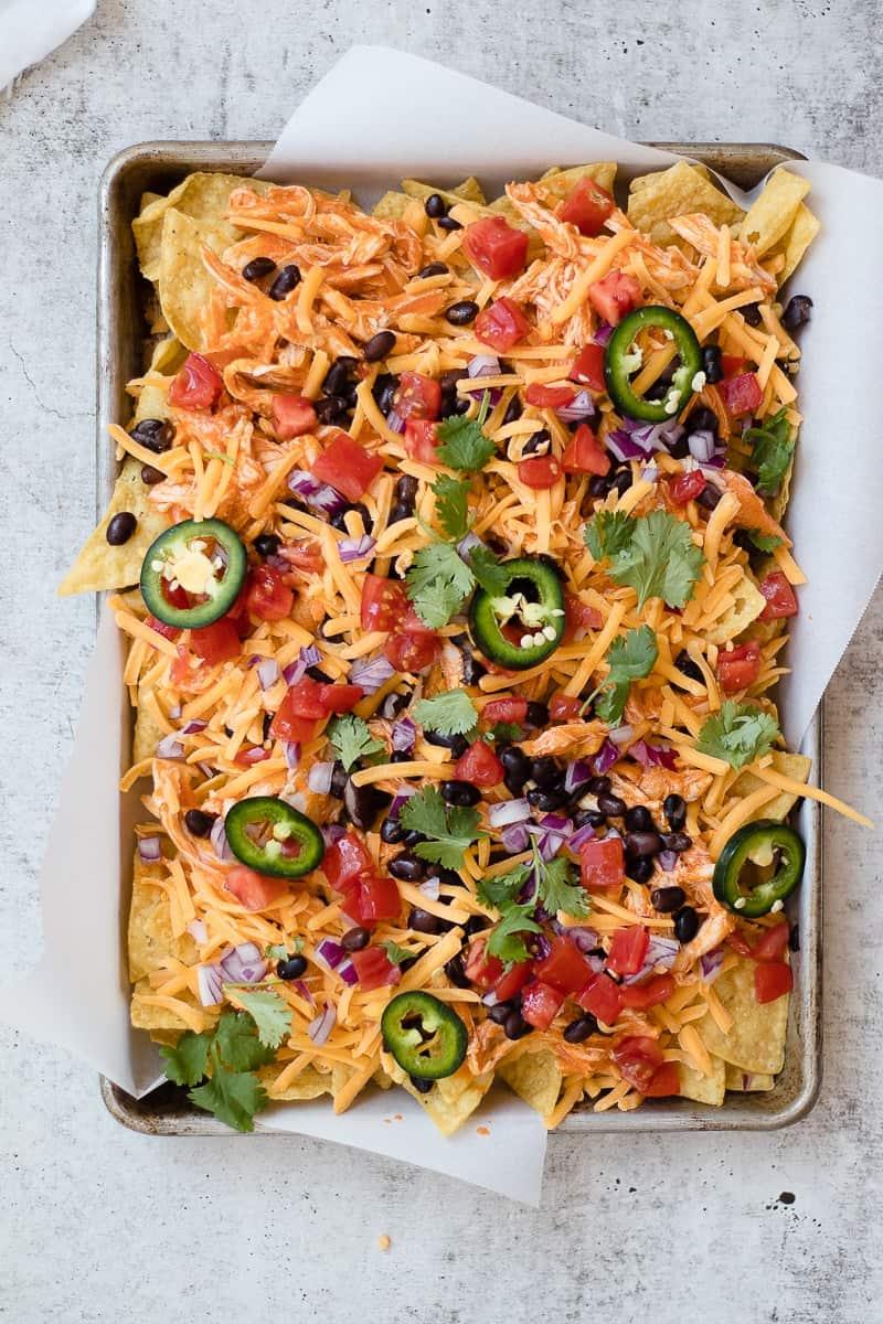 Buffalo Chicken Nachos | homemade nacho recipes | buffalo chicken recipes | nacho recipe ideas | game day food | tailgating recipes | easy appetizer recipes | chicken appetizers | nacho appetizers | how to make chicken nachos || Oh So Delicioso #nachorecipes