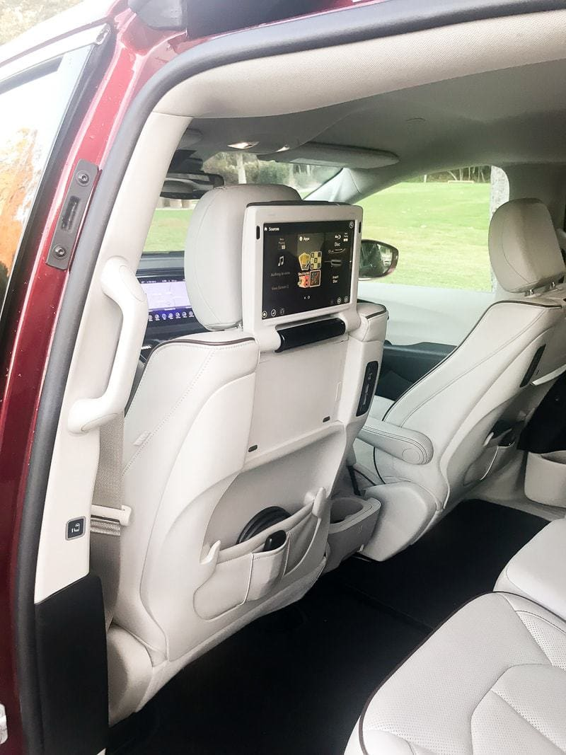 open car door showing tv on back of seat