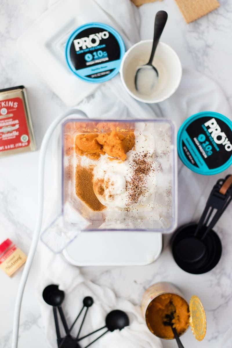 Protein Pumpkin Pie Shake ingredients in a blender