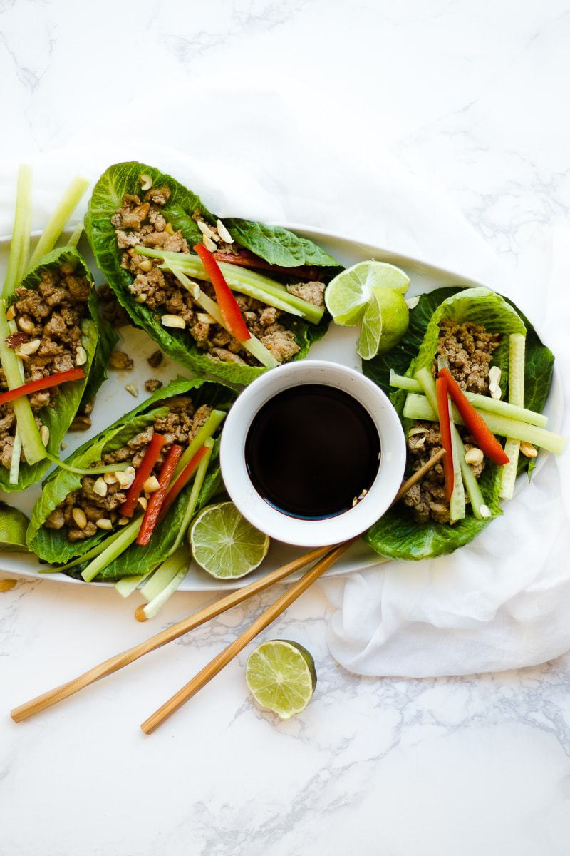 Thai Lettuce Wraps on platter with chopsticks and dipping sauce