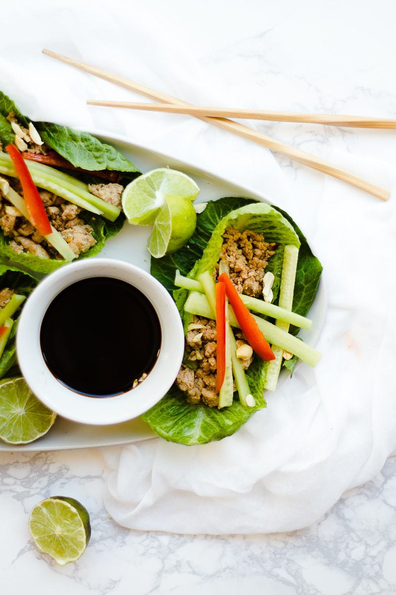 Thai Lettuce Wraps on plate with dipping sauce on plate