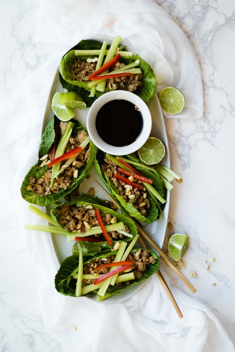Thai Lettuce Wraps on platter with sauce and chopsticks