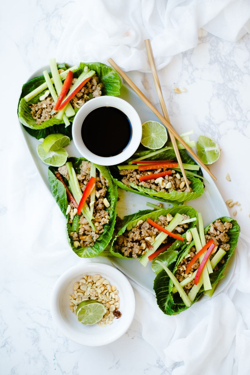 Thai Lettuce Wraps on platter with dipping sauce and chopsticks