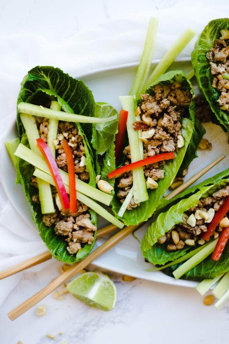 Thai Lettuce Wraps close up shot, chopsticks on plate as well