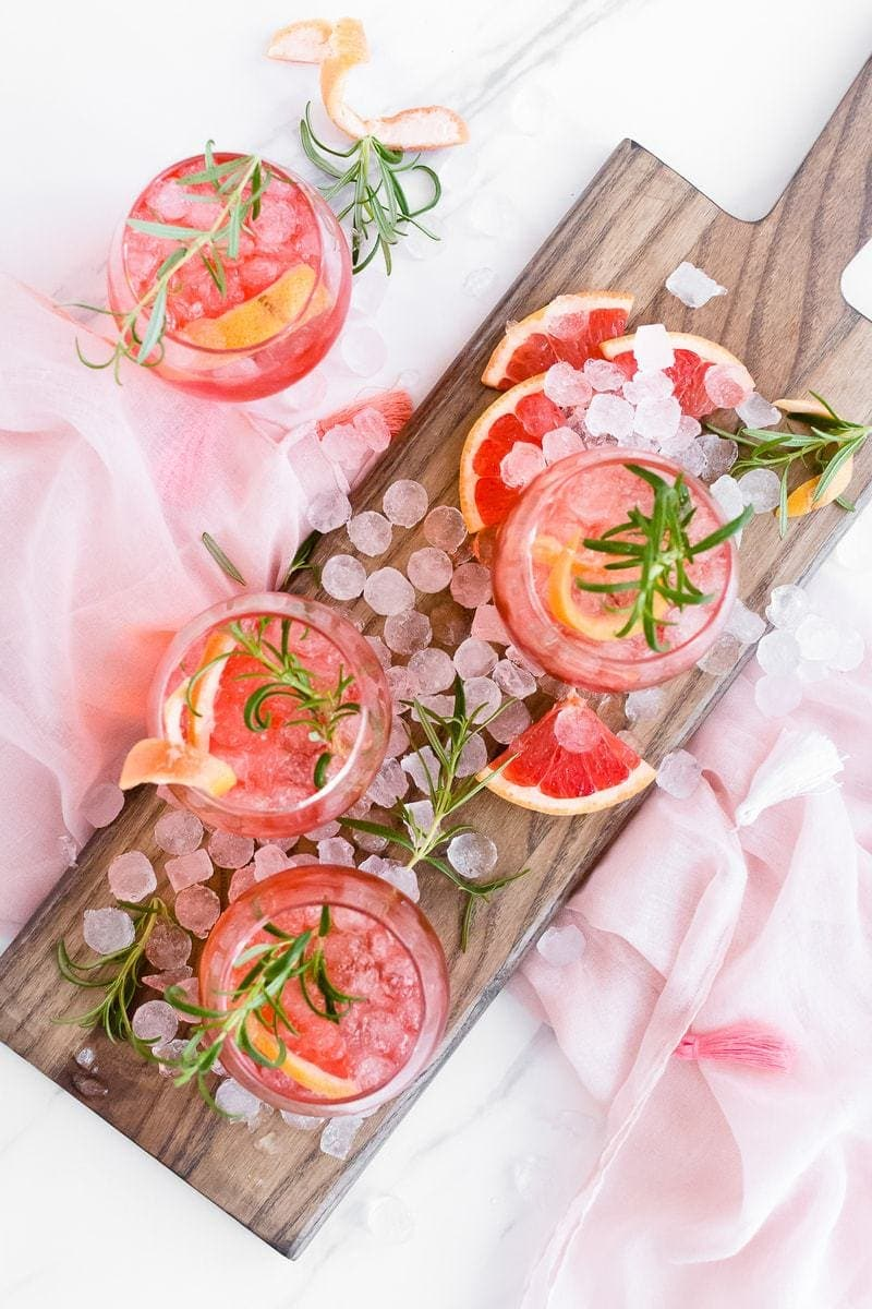 Ruby Red Grapefruit Sparkler on a wooden board with garnishes