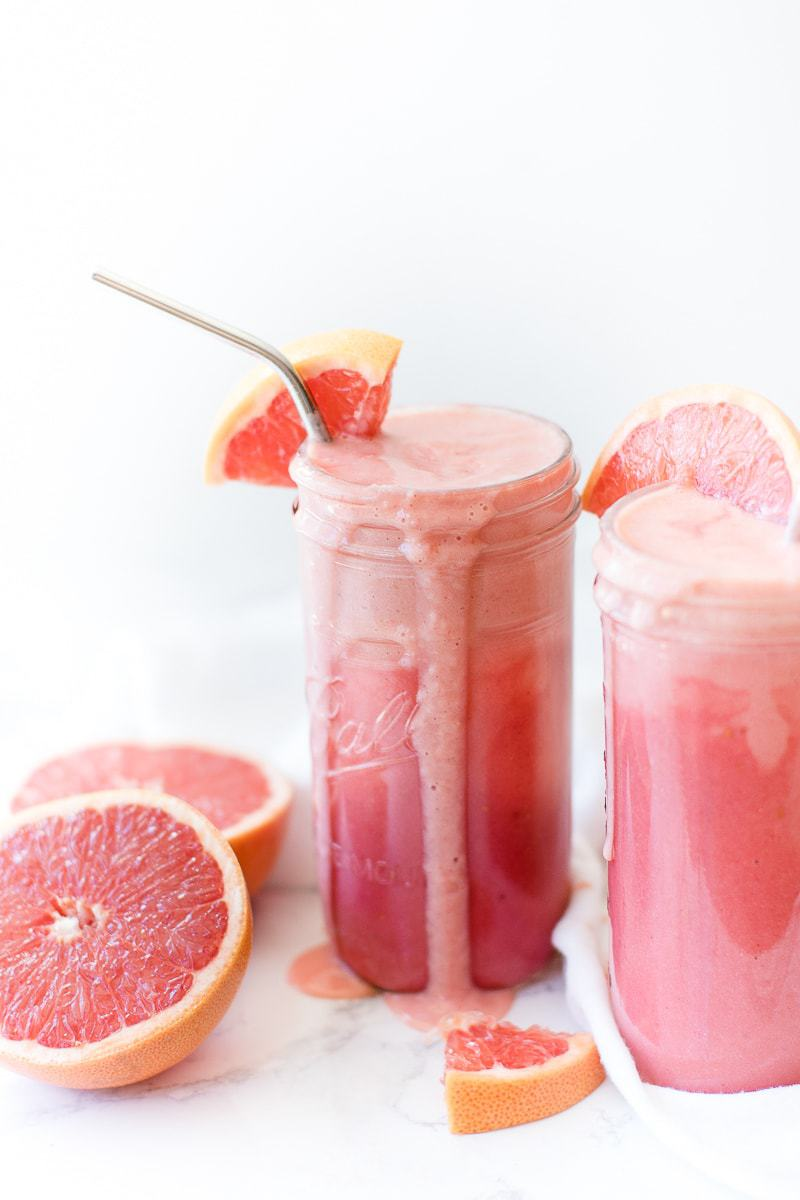 Strawberry Grapefruit Smoothie in a mason jar with cut grapefruit