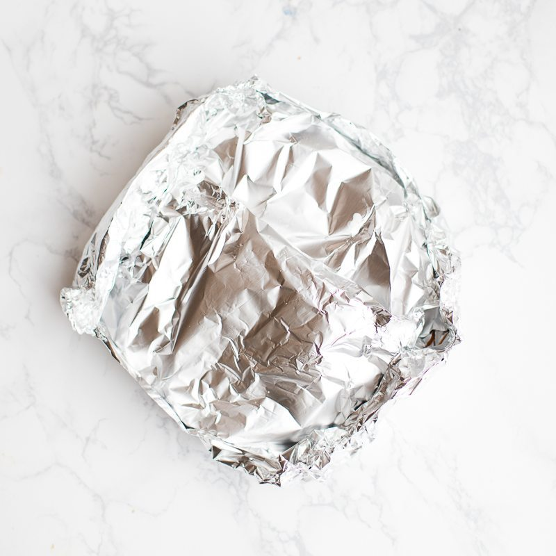 cheeseburger meatloaf wrapped in aluminum foil