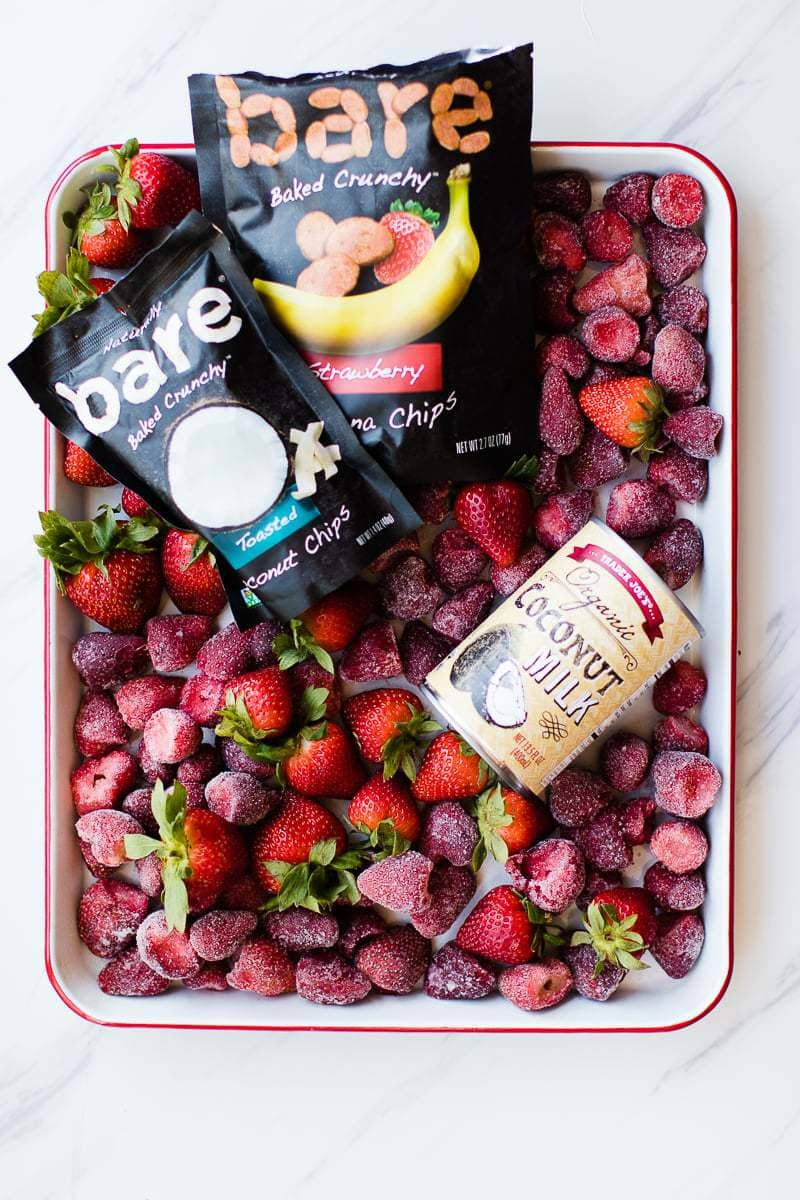 coconut strawberry smoothie ingredients in a tray