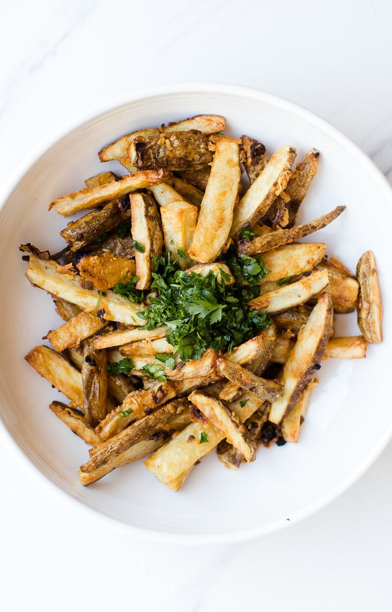 Garlic Parmesan Fries recipe topped with herbs