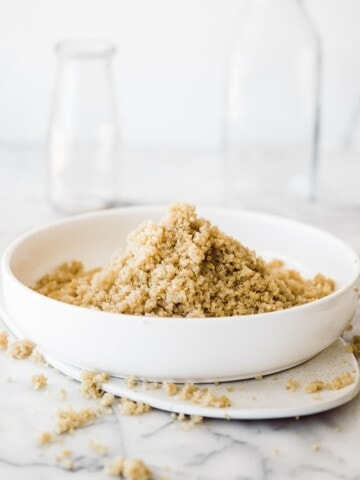 white quinoa in a white bowl with white backgound