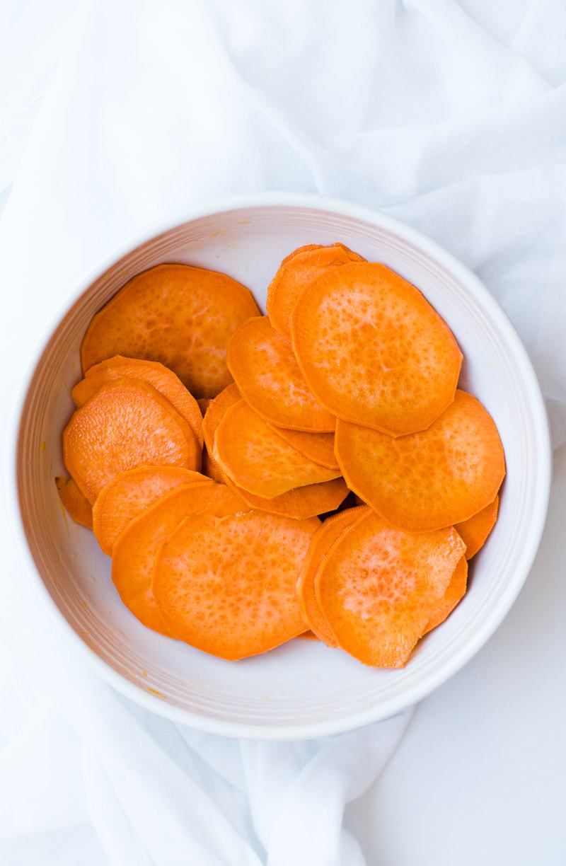 uncooked sweet potato slices in bowl