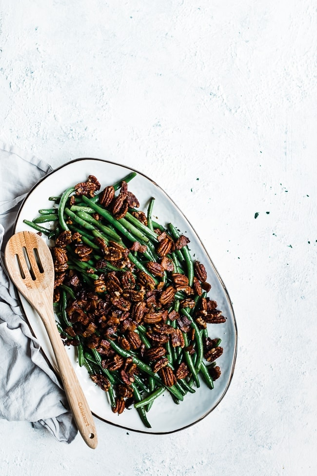 Candied Green Beans - on a white platter atop a grey napkin.