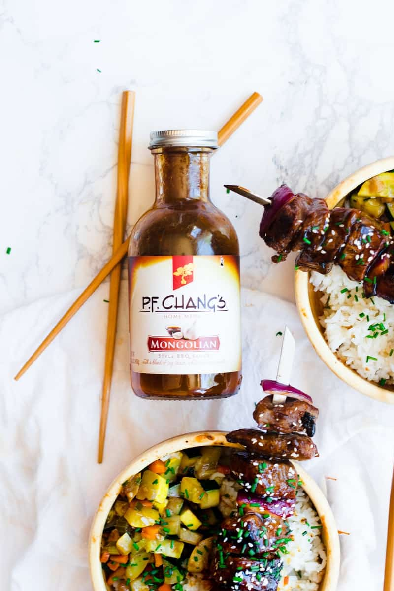 Mongolian BBQ Beef Skewers on Veggie Bowls next to P.F. Chang's bottle