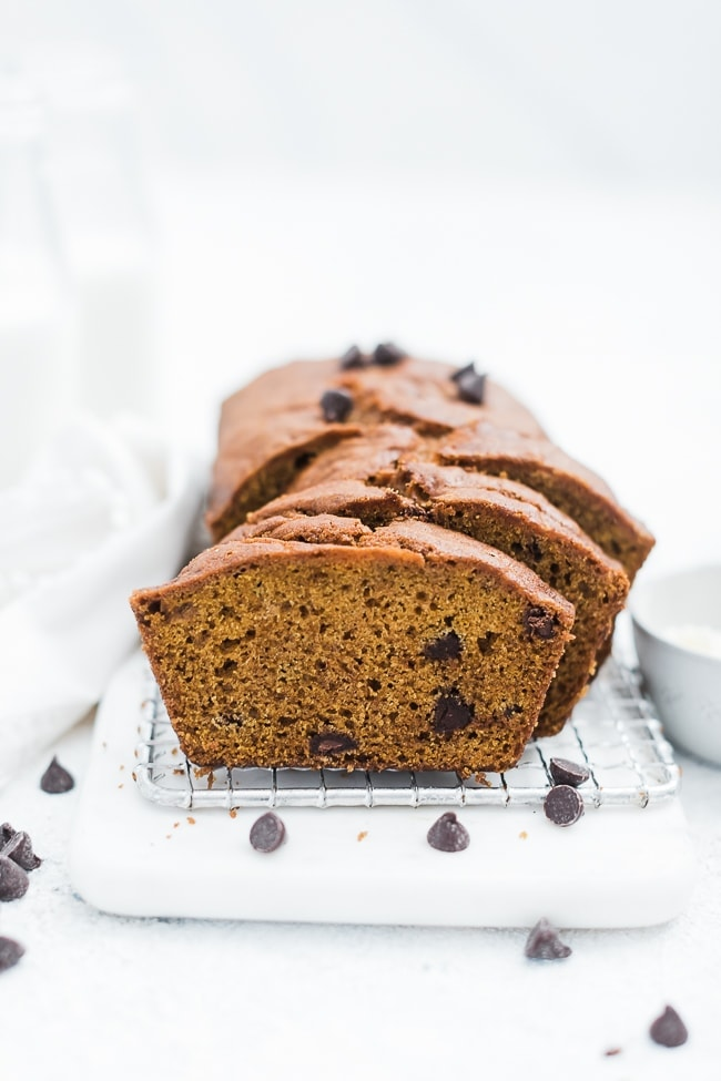 Easy Pumpkin Bread Recipe sliced on a cooling rack.