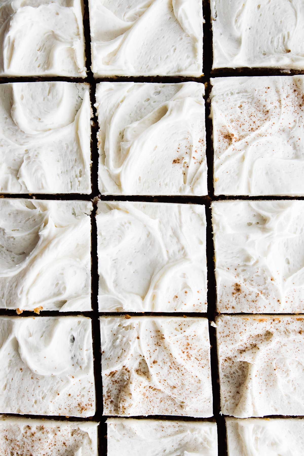 grid of frosted pumpkin cake