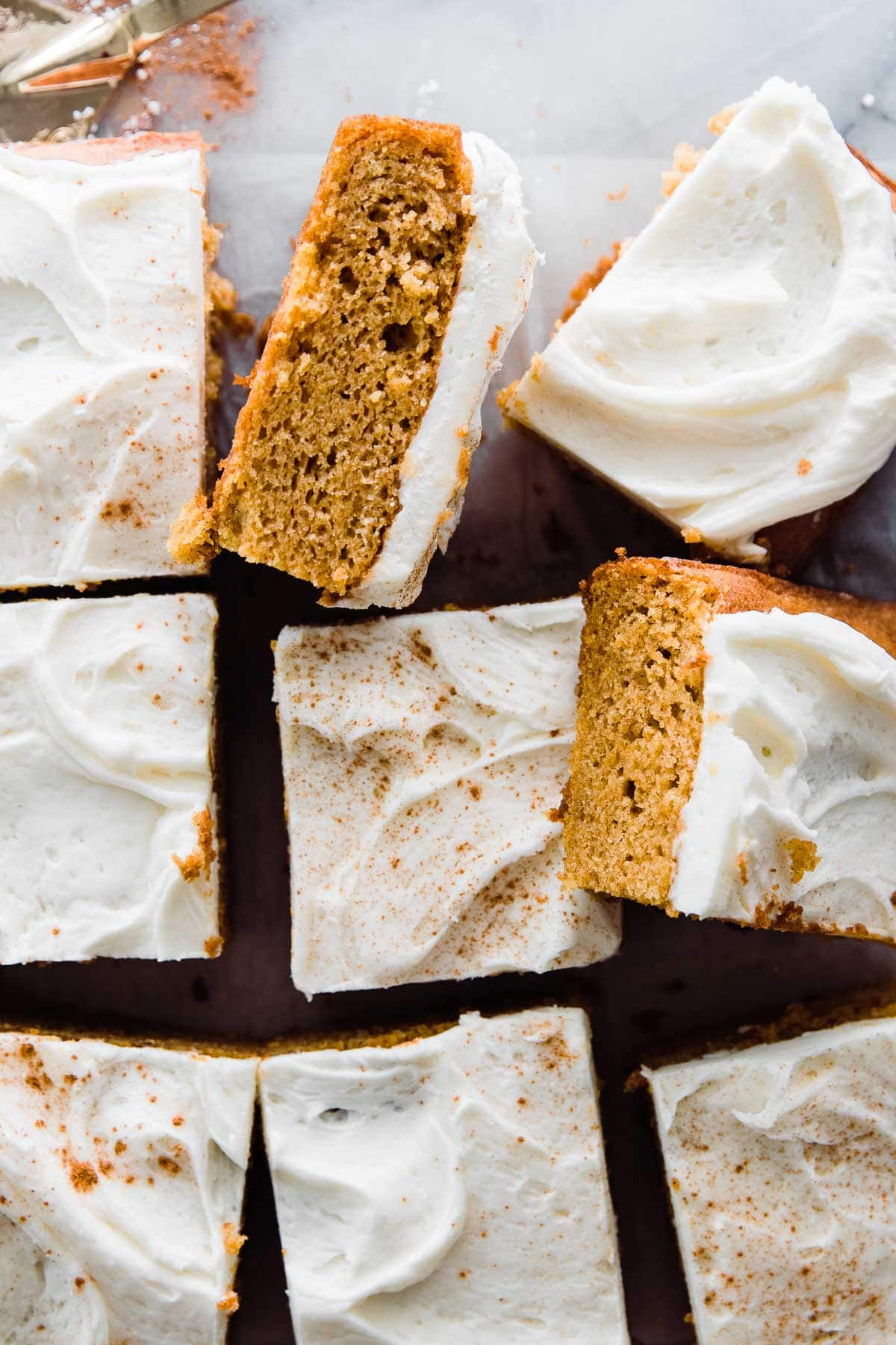 slices of frosted pumpkin cake hap hazardly placed