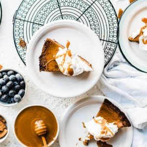 Pumpkin pie with gingersnap crust - on white plates.