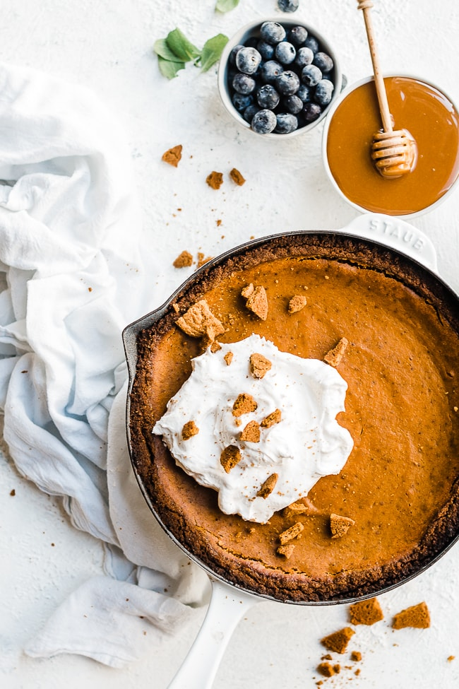 Pumpkin pie with gingersnap crust - in a white cast iron skillet.