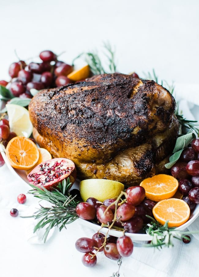 smoked turkey breast with fruit grapes and herbs for garnish