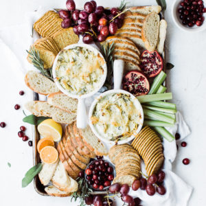 platter of crackers with hot spinach artichoke dip