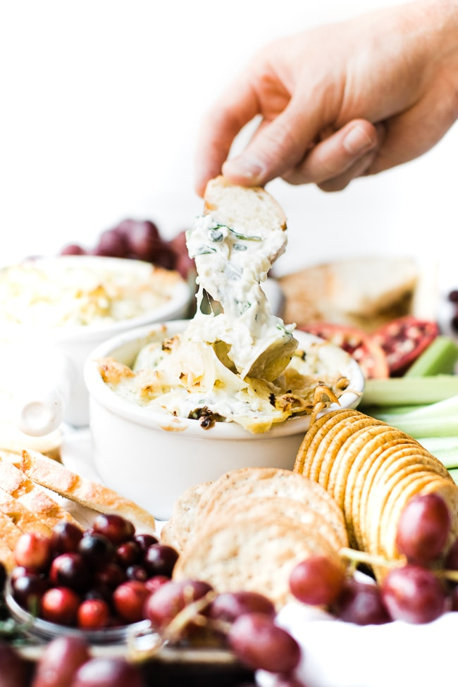 baguette dipped into cheesy dip