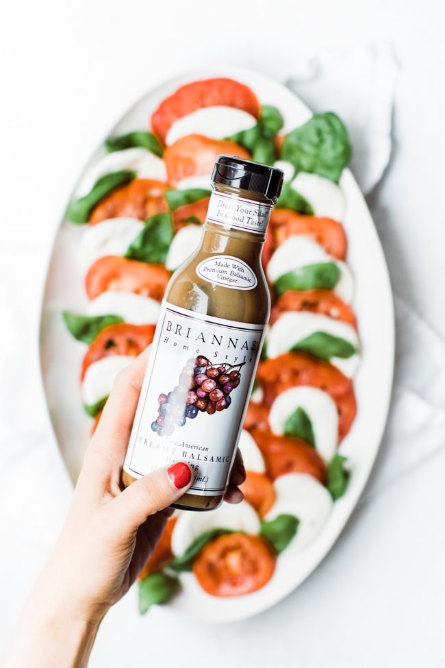 hand holding a bottle of balsamic dressing