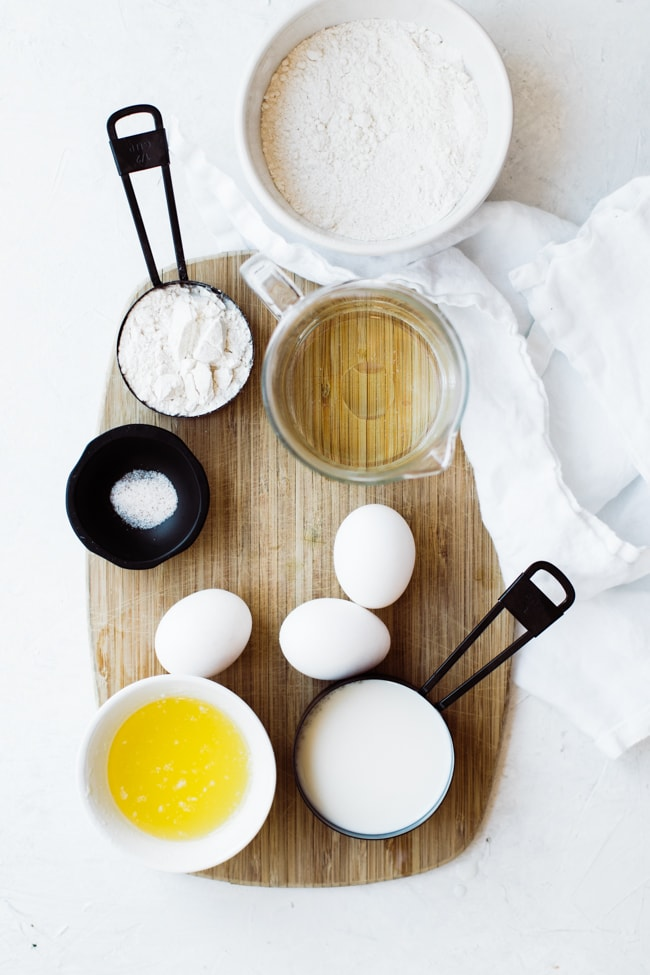 ingredients for crepes on a cutting board