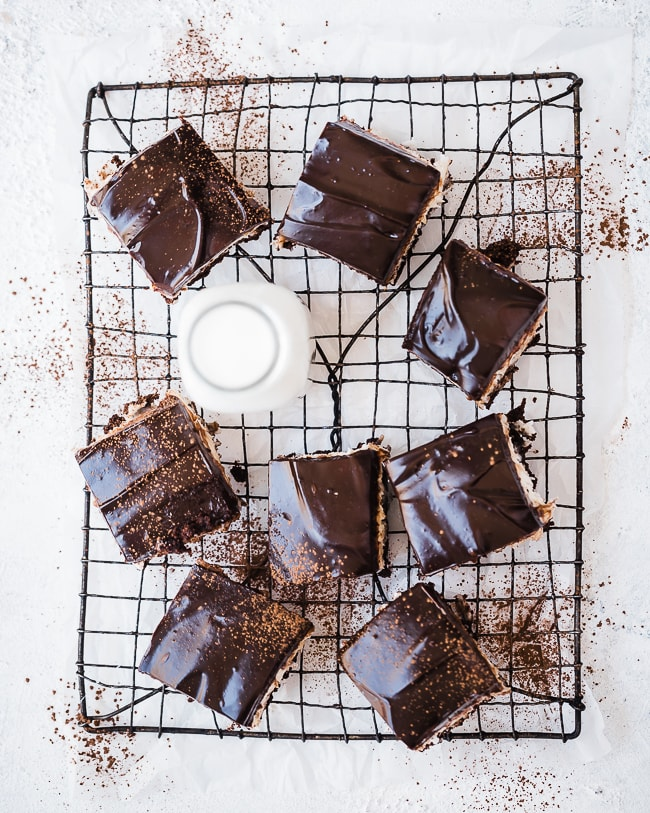 Almond joy brownies on a cooling rack, with a glass of milk.