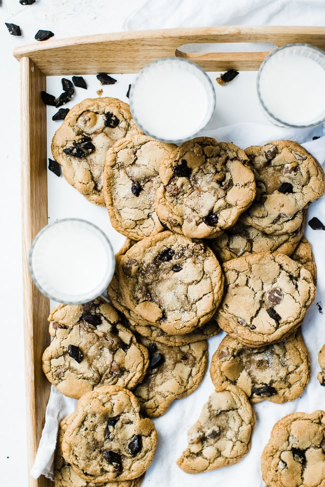cookies and glasses of milk on serving tray