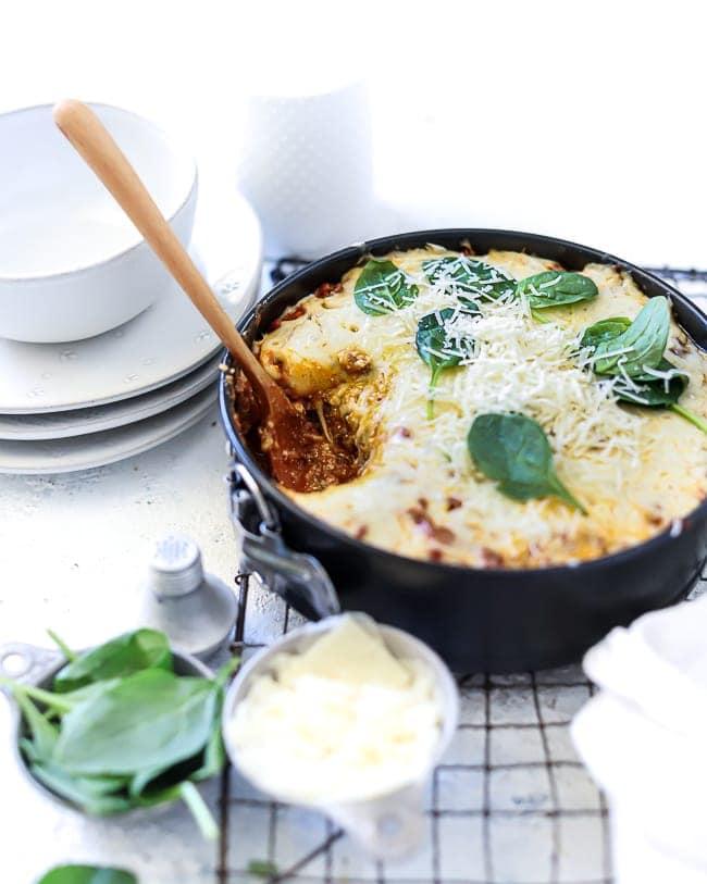 A ¾ shot of keto lasagna in a metal springform pan.