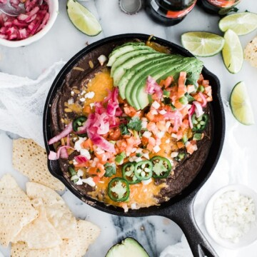loaded black beans in a cast iron skillet
