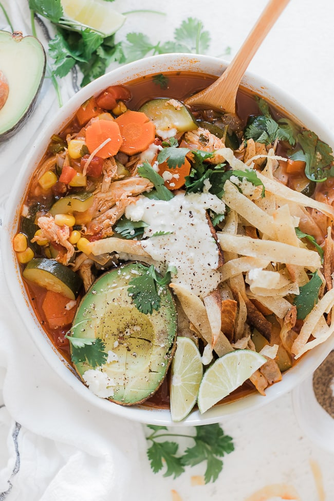 Mexican chicken tortilla soup in a grey bowl.