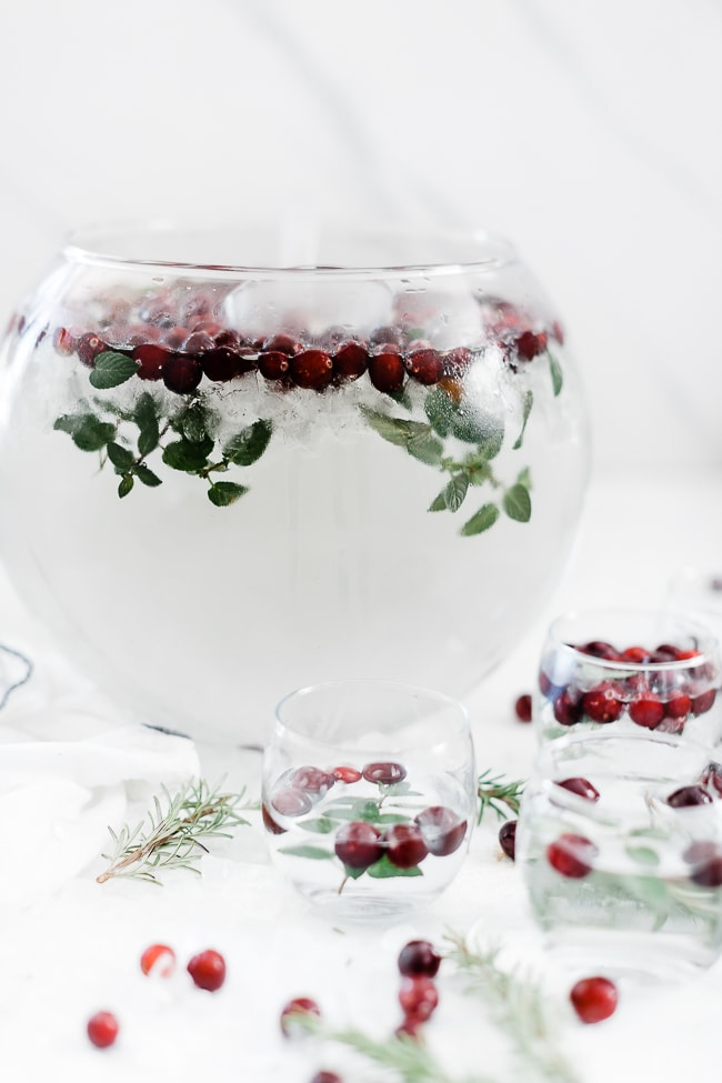 Cranberry mint water in a glass punch bowl.