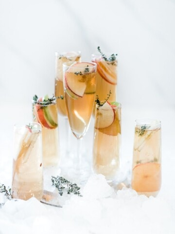 Thanksgiving punch in champagne glasses, on top of crushed ice.
