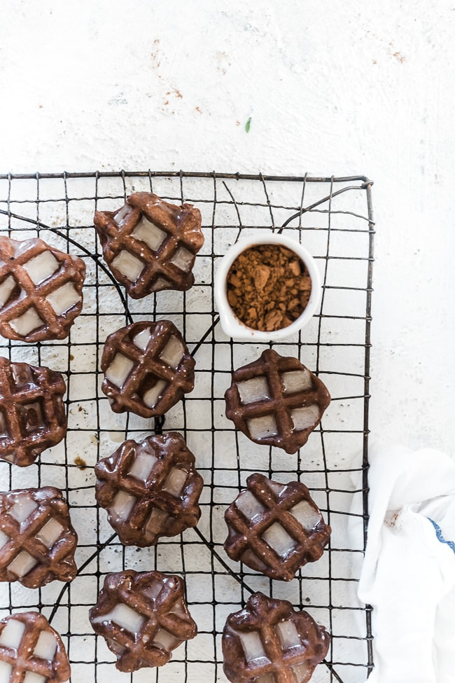 Waffle cookies on a cooling rack.