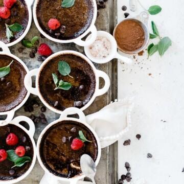 Chocolate creme brûlée in white tart dishes.