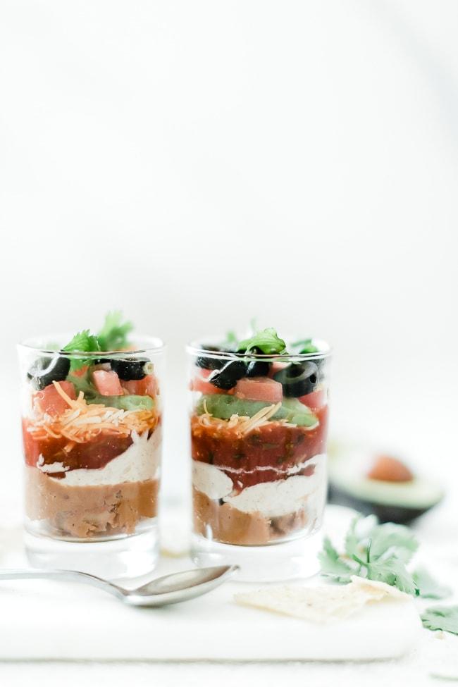 7 layer dip recipe in individual cups.